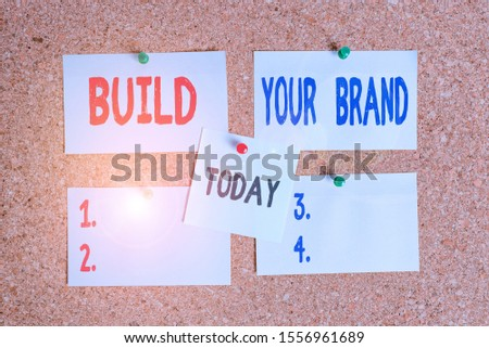 Text sign showing Build Your Brand. Conceptual photo enhancing brand equity using advertising campaigns Corkboard color size paper pin thumbtack tack sheet billboard notice board.