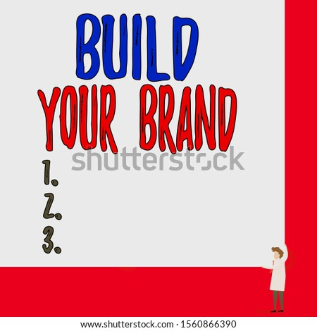 Text sign showing Build Your Brand. Conceptual photo enhancing brand equity using advertising campaigns One man professor wear white coat red tie hold big board use two hands.