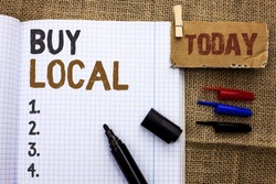 Text sign showing Buy Local. Conceptual photo Buying Purchase Locally Shop Store Market Buylocal Retailers written on Notebook Book With Marker on the jute background Today.
