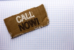 Text sign showing Call Now. Conceptual photo Contact Talk Chat Hotline Support Telephony Customer Service written on tear Cardboard Piece on the Check background.