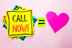 Text sign showing Call Now. Conceptual photo Contact Talk Chat Hotline Support Telephony Customer Service written on Stacked Sticky Note Papers on the plain background with Heart next to it.