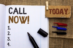 Text sign showing Call Now. Conceptual photo Contact Talk Chat Hotline Support Telephony Customer Service written on Notebook Book With Marker on the jute background Today.