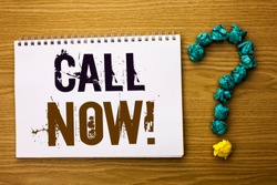 Text sign showing Call Now. Conceptual photo Contact Talk Chat Hotline Support Telephony Customer Service written on Notebook Book on the Wooden background Ask for.
