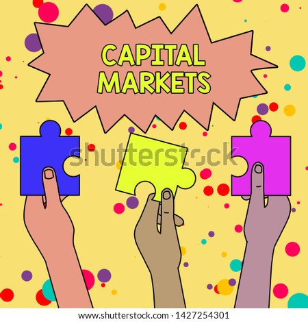 Text sign showing Capital Markets. Conceptual photo Allow businesses to raise funds by providing market security Three Colored Empty Jigsaw Puzzle Pieces Held in Different People Hands.