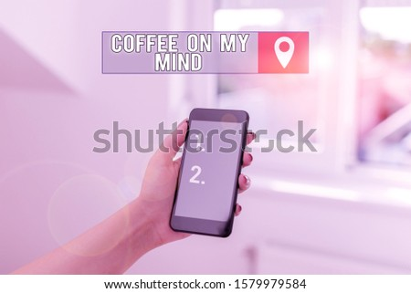 Text sign showing Coffee On My Mind. Conceptual photo Addiction to Coffee Starbucks Thinking of breaktime woman using smartphone office supplies technological devices inside home.