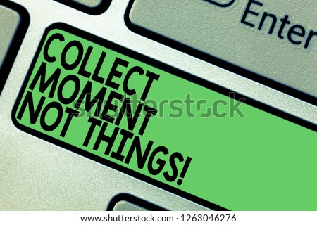 Text sign showing Collect Moment Not Things. Conceptual photo Keep in mind your best moments is valuable Keyboard key Intention to create computer message pressing keypad idea. #1263046276