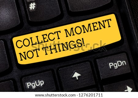 Text sign showing Collect Moment Not Things. Conceptual photo Keep in mind your best moments is valuable Keyboard key Intention to create computer message pressing keypad idea. #1276201711