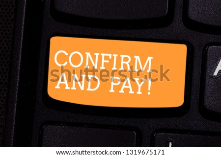 Text sign showing Confirm And Pay. Conceptual photo Check out your purchases and make a payment Confirmation Keyboard key Intention to create computer message pressing keypad idea. #1319675171