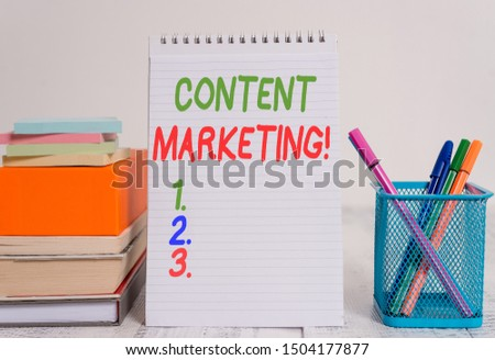 Text sign showing Content Marketing. Conceptual photo involves creation and sharing of online material Pens metal holder stacked note pads books square box spiral wooden table. #1504177877