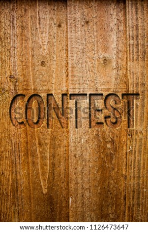 Text sign showing Contest. Conceptual photo Game Tournament Competition Event Trial Conquest Battle Struggle Ideas messages wooden background intentions feelings thoughts communicate. #1126473647