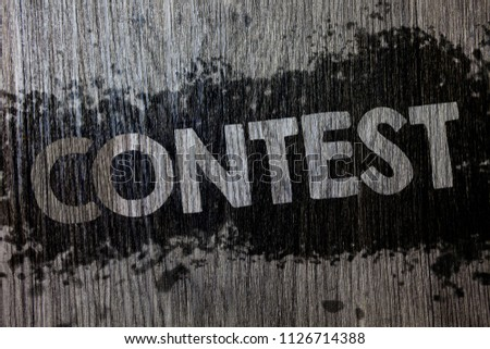 Text sign showing Contest. Conceptual photo Game Tournament Competition Event Trial Conquest Battle Struggle Wooden wood background black splatter paint ideas messages intentions. #1126714388