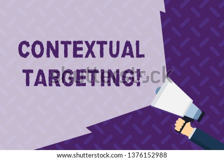 Text sign showing Contextual Targeting. Conceptual photo targeted advertising for ads appearing on websites Hand Holding Megaphone with Blank Wide Beam for Extending the Volume Range.