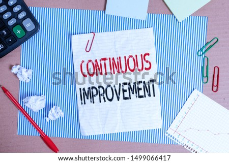 Text sign showing Continuous Improvement. Conceptual photo ongoing effort to improve products or processes Striped paperboard notebook cardboard office study supplies chart paper.