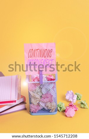 Text sign showing Continuous Improvement. Conceptual photo ongoing effort to improve products or processes Trash bin crumpled paper clothespin empty reminder office supplies yellow.