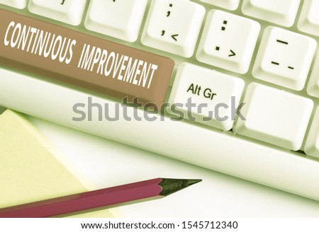 Text sign showing Continuous Improvement. Conceptual photo ongoing effort to improve products or processes White pc keyboard with empty note paper above white background key copy space.