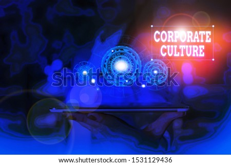Text sign showing Corporate Culture. Conceptual photo pervasive values and attitudes that characterize a company Woman wear formal work suit presenting presentation using smart device.