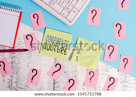 Text sign showing Corporate Culture. Conceptual photo pervasive values and attitudes that characterize a company Writing tools, computer stuff and math book sheet on top of wooden table.
