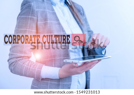 Text sign showing Corporate Culture. Conceptual photo pervasive values and attitudes that characterize a company Business concept with mobile phone and business woman.