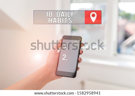 Text sign showing 10 Daily Habits. Conceptual photo Healthy routine lifestyle Good nutrition Exercises woman using smartphone office supplies technological devices inside home.