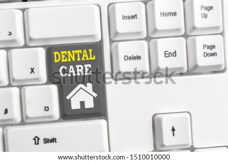 Text sign showing Dental Care. Conceptual photo maintenance of healthy teeth or to keep it clean for future White pc keyboard with empty note paper above white background key copy space.
