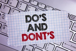 Text sign showing Do'S And Don'Ts. Conceptual photo What can be done and what cannot be knowing right wrong written Tear Notebook paper placed the Laptop.