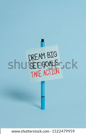Text sign showing Dream Big Set Goals Take Action. Conceptual photo Motivation to follow your dreams Inspiration Ballpoint blank colored sticky note peaceful cool pastel fashion background. #1522479959