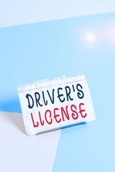 Text sign showing Driver S License. Conceptual photo a document permitting a demonstrating to drive a motor vehicle Paper placed tilted above buffer wire on soft pastel multi colours backdrop.