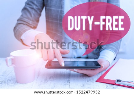 Text sign showing Duty Free. Conceptual photo Store or establisbhement that sells imported products witout tax Business woman sitting with mobile phone and cup of coffee on the table.