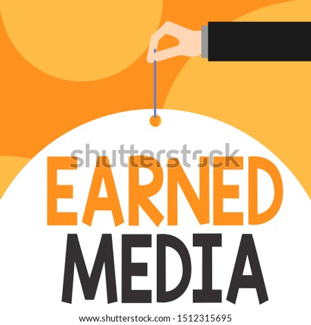Text sign showing Earned Media. Conceptual photo Publicity gained through promotional efforts by multimedia Male hand arm needle punching big half blank balloon geometrical background.