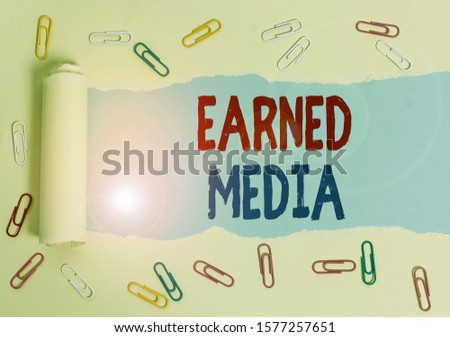 Text sign showing Earned Media. Conceptual photo publicity gained through promotional efforts other than paid.
