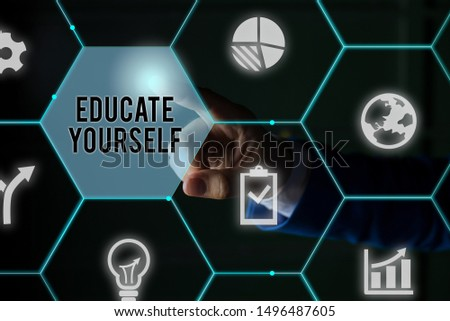 Text sign showing Educate Yourself. Conceptual photo prepare oneself or someone in a particular area or subject Male human wear formal work suit presenting presentation using smart device.