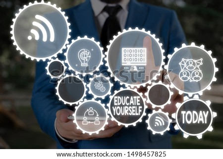 Text sign showing Educate Yourself. Conceptual photo prepare oneself or someone in a particular area or subject Male human wear formal work suit presenting presentation using smart device. #1498457825