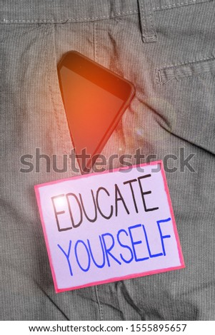 Text sign showing Educate Yourself. Conceptual photo prepare oneself or someone in a particular area or subject Smartphone device inside formal work trousers front pocket near note paper. #1555895657
