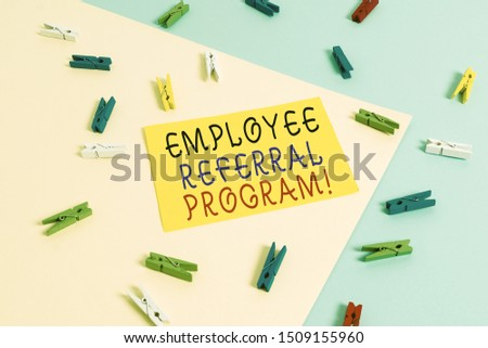 Text sign showing Employee Referral Program. Conceptual photo internal recruitment method employed by organizations Colored clothespin paper empty reminder yellow blue floor background office. #1509155960