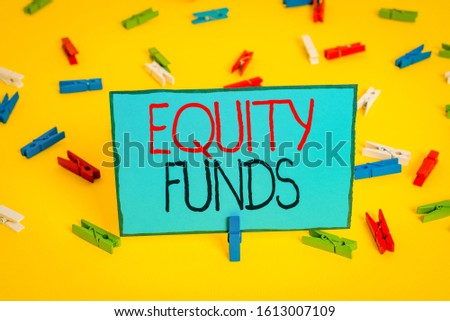 Text sign showing Equity Funds. Conceptual photo type of mutual fund that buys ownership in businesses Colored clothespin papers empty reminder yellow floor background office.