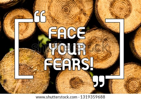 Text sign showing Face Your Fears. Conceptual photo Have the courage to overcome anxiety be brave fearless Wooden background vintage wood wild message ideas intentions thoughts. #1319359688