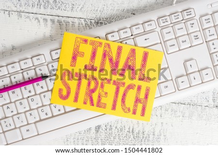 Text sign showing Final Stretch. Conceptual photo Last Leg Concluding Round Ultimate Stage Finale Year ender White keyboard office supplies empty rectangle shaped paper reminder wood. Foto d'archivio ©