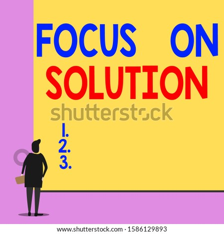 Text sign showing Focus On Solution. Conceptual photo Give full attention on dealing answer of the situation Back view young woman watching blank big rectangle. Geometrical background.