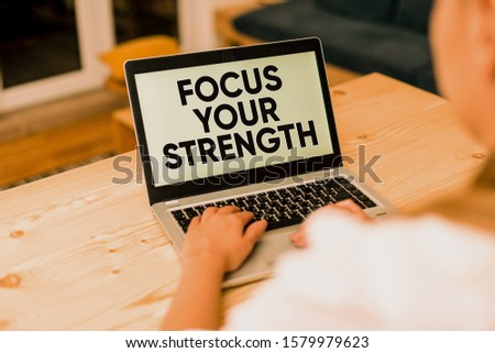 Text sign showing Focus Your Strength. Conceptual photo Improve skills work on weakness points think more woman laptop computer smartphone mug office supplies technological devices.
