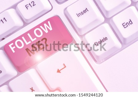 Text sign showing Follow Me Question. Conceptual photo go or come after demonstrating or thing proceeding ahead White pc keyboard with empty note paper above white background key copy space. #1549244120