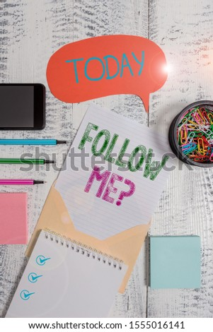 Text sign showing Follow Me Question. Conceptual photo go or come after demonstrating or thing proceeding ahead Envelop speech bubble smartphone sheet pens spiral notepads clips wooden.