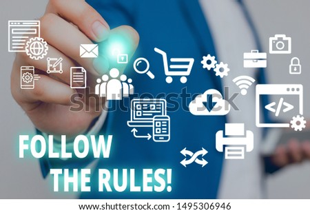 Text sign showing Follow The Rules. Conceptual photo go with regulations governing conduct or procedure Male human wear formal work suit presenting presentation using smart device.