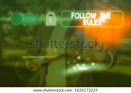 Text sign showing Follow The Rules. Conceptual photo order someone stick to certain place country guides stricts.