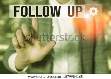 Text sign showing Follow Up. Conceptual photo Additional info or any activity that needs to check secondly Business woman in the nature pointing with the finger into empty space.