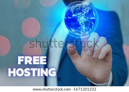 Photo of Text sign showing Free Hosting. Conceptual photo business of providing storage space and access for websites Elements of this image furnished by NASA.