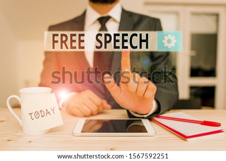 Text sign showing Free Speech. Conceptual photo the right of showing to express their opinions publicly Male human wear formal clothes present presentation use hi tech smartphone.