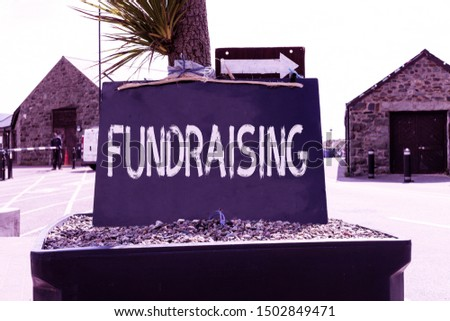 Text sign showing Fundraising. Conceptual photo act of collecting or producing money for a particular purpose Empty black board with copy space for advertising. Blank dark board.