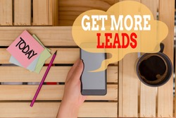 Text sign showing Get More Leads. Conceptual photo to have more customers and improve your target sales woman computer smartphone drink mug office supplies technological devices.