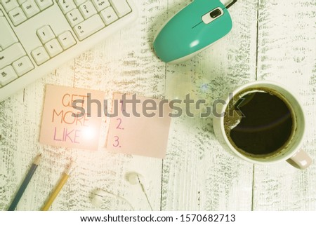 Text sign showing Get More Like. Conceptual photo Thumbs up Hashtags Page Plugin Approvals Followers technological devices colored reminder paper office supplies keyboard mouse. #1570682713