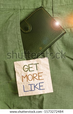 Text sign showing Get More Like. Conceptual photo Thumbs up Hashtags Page Plugin Approvals Followers Small little wallet inside man trousers front pocket near notation paper. #1573272484